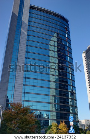 A building shines against a clear, blue sky.