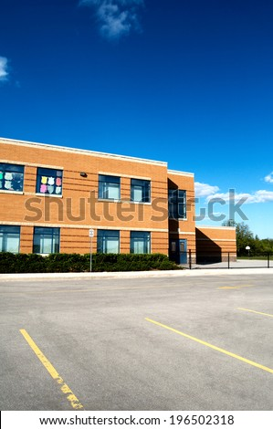 A building with double doors and pictures in some of the windows. - stock photo