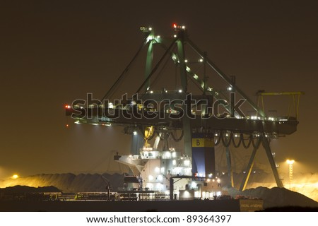 A bulk-carrier supplying cargo (coal) to the port of Rotterdam - stock photo