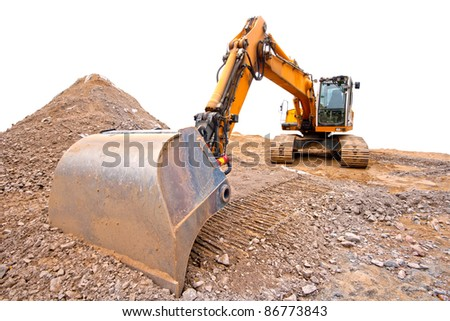 A bulldozer in the construction site, isolated on white
