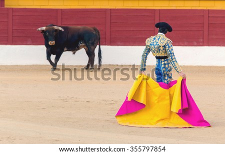 A bullfighter awaiting for the bull in the bullring. Corrida de toros - stock photo