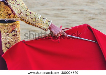 A bullfighter awaiting for the bull with his cape and sword. Corrida de toros - stock photo