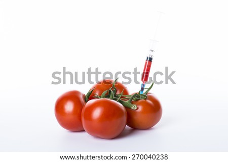 A bunch of a genetically modified fresh, red and juicy tomatoes isolated