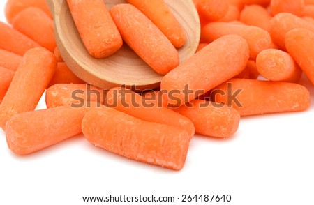 a bunch of baby carrot and wooden spoon on white background  - stock photo