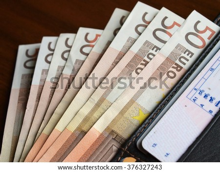 a bunch of banknotes inside wallet