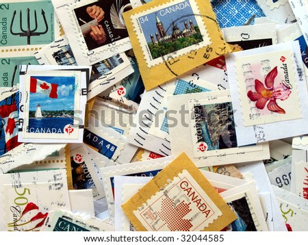 a bunch of Canadian postage stamps from Canada - stock photo