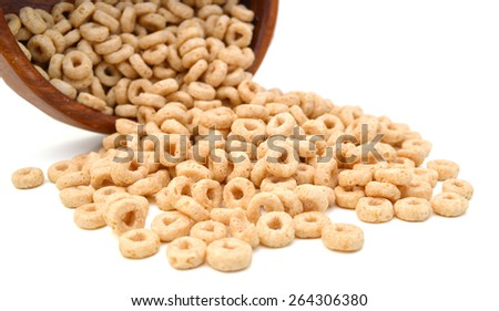 a bunch of cereal loops in bowl on white background  - stock photo