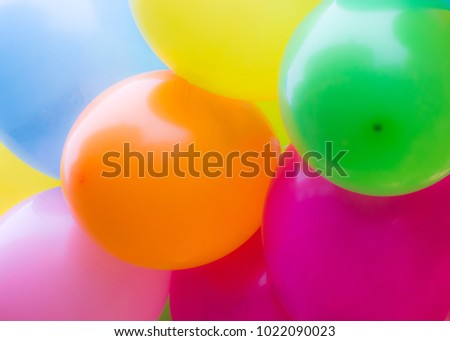 A bunch of colorful balloons with selective focus