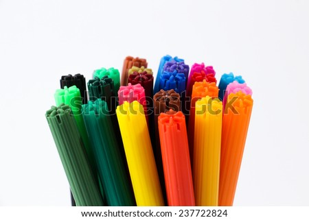 A bunch of colorful pens against white background, showing only the tips. - stock photo