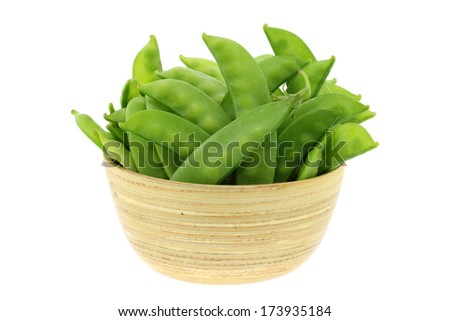 A bunch of fresh Peas in a wooden bowl isolated on white background - stock photo