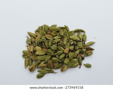 a bunch of green cardamon seeds - stock photo