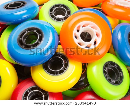 A bunch of inline skate wheels - stock photo