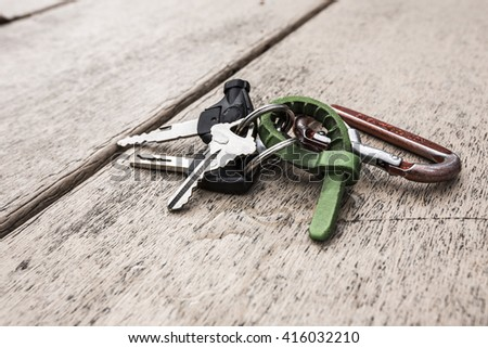 A bunch of keys on the wooden table. Keys on the table. Key chain. Shackle, carabiner - stock photo