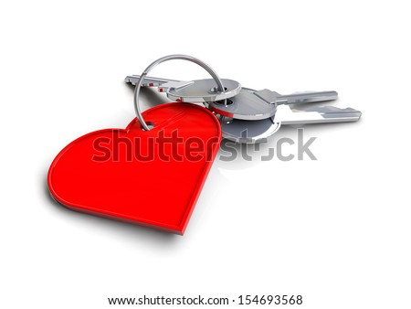 A bunch of keys with a heart key ring attached. Symbolizes a key to my heart. - stock photo