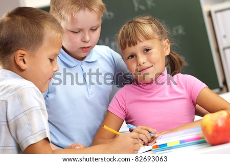 a bunch of kids talking during the break - stock photo