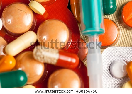 A bunch of medicine in close up photo lying on table