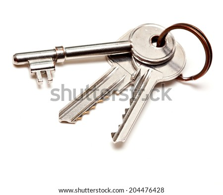 A bunch of modern door keys on ring on white background - stock photo