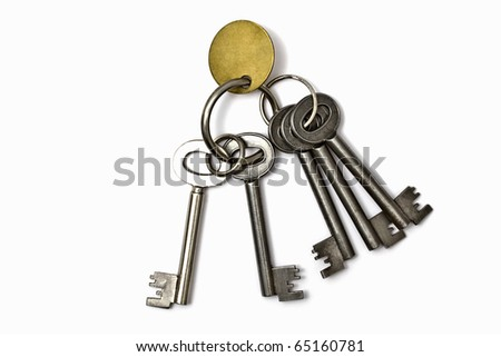 A bunch of old keys isolated on white background