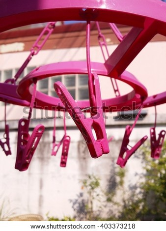 A  bunch  of  pink  clothespin, close  up - stock photo