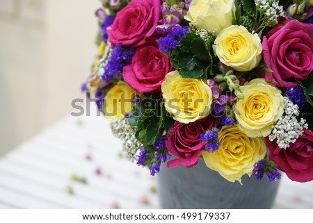 A bunch of pink roses and yellow roses combine with other flowers - flower design, flower decoration - a special gift for women's day