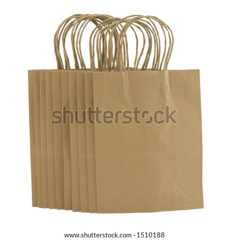 A bunch of plain brown paper shopping bags - stock photo