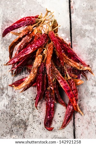 A Bunch of Red hot chili peppers on old vintage wooden  background - stock photo