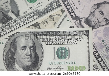 A bunch of scattered dollars - stock photo