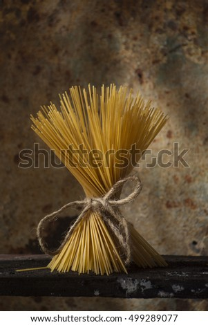A bunch of spaghetti, typical hard cheese of the Italian cuisine