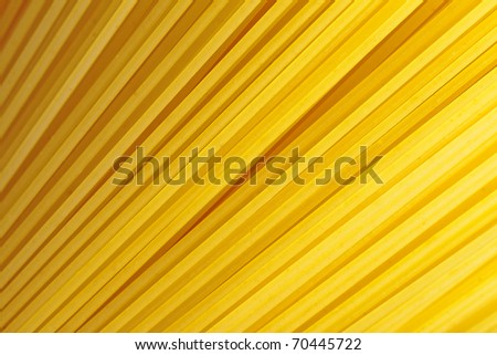 A bunch of spaghetti, uncooked spaghetti noodles background.