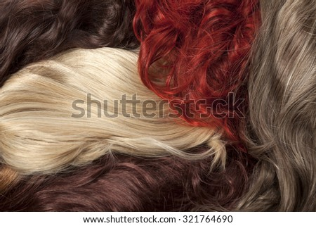 a bunch of wigs in different colors