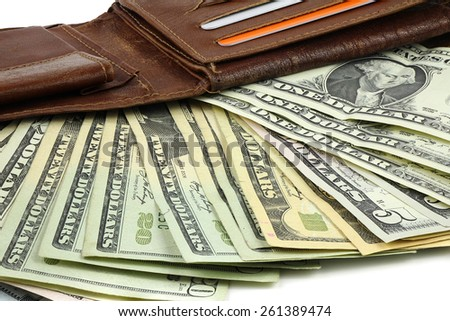 A bundle of Dollar banknotes in a brown leather wallet - stock photo