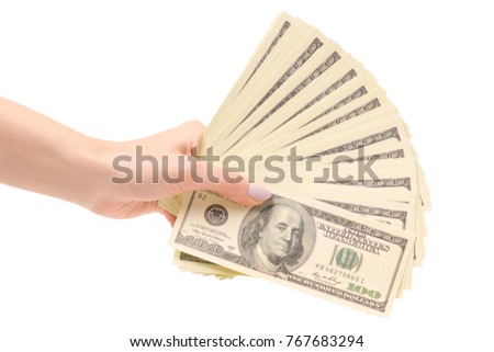 A bundle of money dollars in hands on a white background isolation