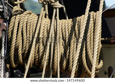 A bundle of rope on a tall ship at the harbor. - stock photo