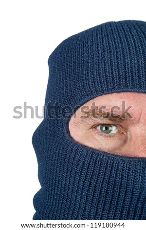 A burglar wearing a blue ski mask to hide his identity. Isolated on white for user convenience. - stock photo