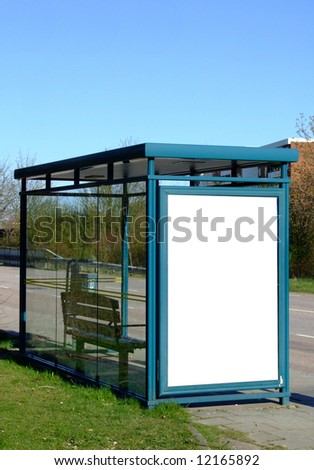 a bus stop with a blank billboard for your advertising - stock photo