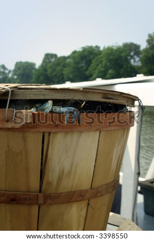 A Bushel of Blue Crabs on the Dock with one trying to escape