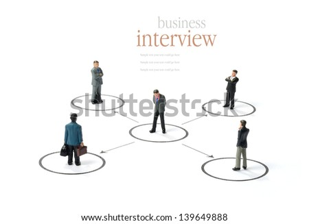A business concept image of a business man being assessed by others against a white background. Copy space. - stock photo