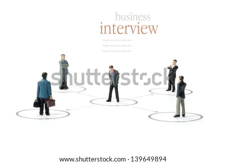 A business concept image of a business man being assessed by others against a white background. Copy space.