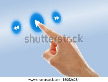 a business hand press play button on touch screen  - stock photo
