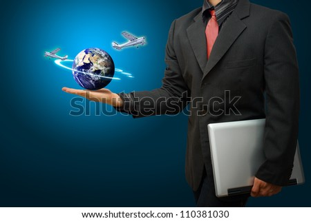 A business man and airplane from globe : Elements of this image furnished by NASA - stock photo