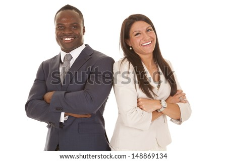 A business man and woman standing back to back with smiles on their faces. - stock photo
