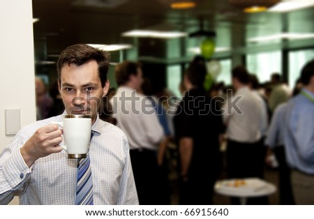 A Business Man Gets A Wake Me Up Coffee Hit During A Conference Morning Tea Break - stock photo