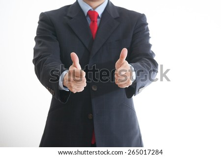 A business man giving the okay sign - stock photo