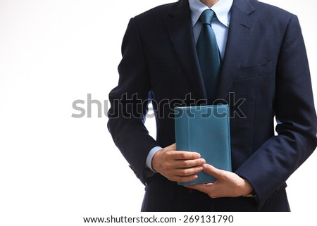 A business man holding a blue note