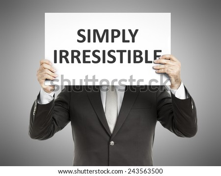 A business man holding a paper in front of his face with the message simply irresistible