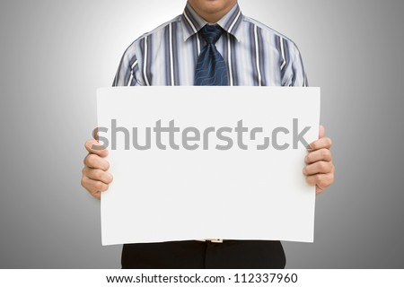 A business man holding blank paper with clipping path - stock photo