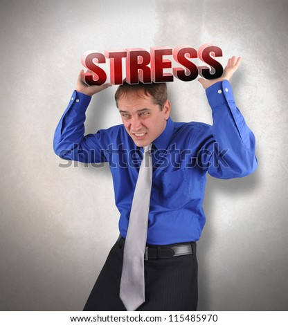 A business man is holding up the text stress and it is heavy for a metaphor concept for debt or money problems. - stock photo