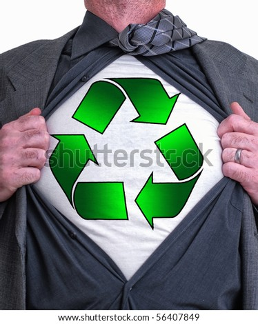 A business man isolated against a white background tearing open his shirt to reveal a recycle sign on a t shirt - stock photo