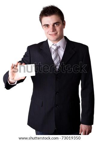 A business man offering you his business card - stock photo