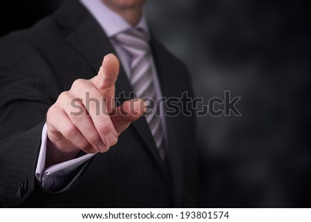 A business man pointing his finger at you. - stock photo